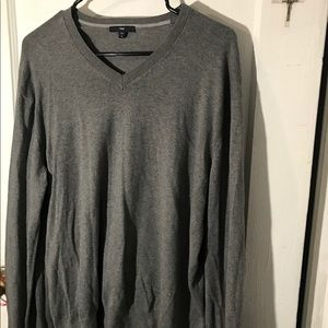 "This is a grey v-neck ""boyfriend"" sweater."